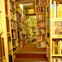 going up the stairs at scathin book shop in cromford derbyshire
